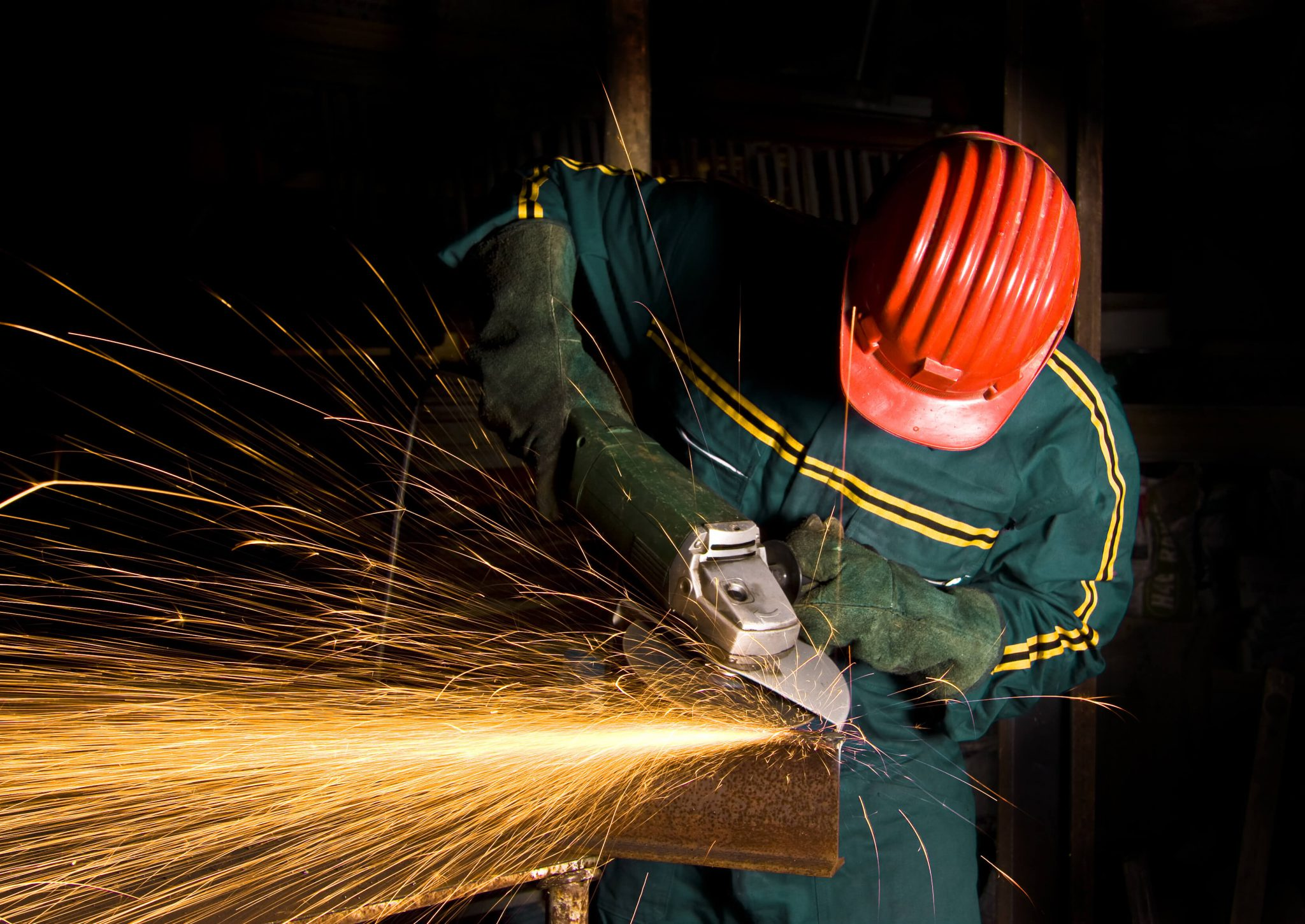 man using angle grinder for finishing processes